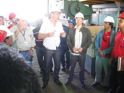 Bruno Verlaeckt, president of AC Antwerpen speaking with workers in El Palito refinery